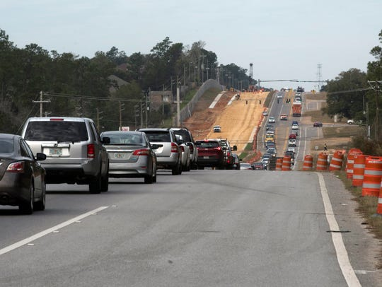 Traffic backs up on Nine Mile Road on Wednesday, Jan.