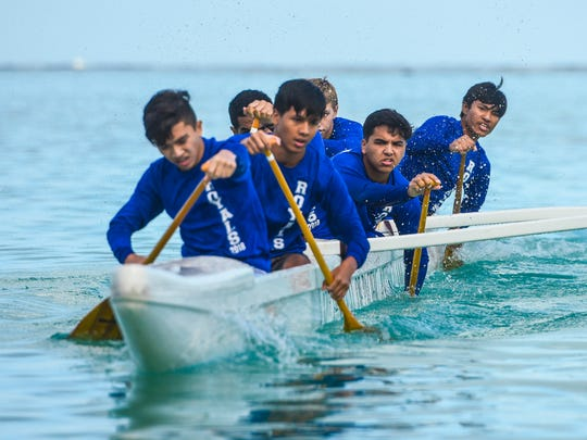 Paddlers of Notre Dame High School's Royals cut their outrigger through the waters of Tumon Bay as they compete in the Independent Interscholastic Athletic Association of Guam and the Guam Kayak and Canoe Federation Paddling series at Matapang Beach on Saturday, April 21, 2018.