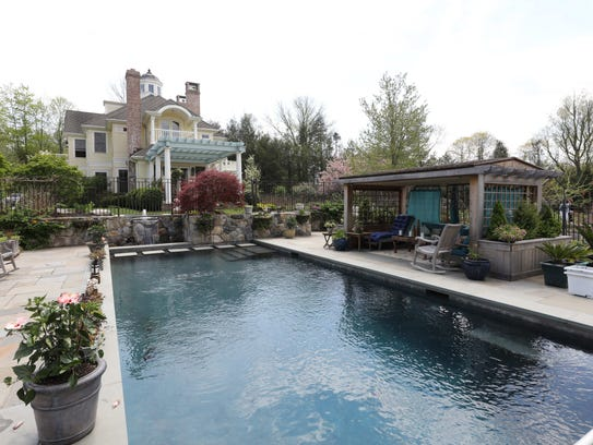 The pool and cabana at the home of Liz Taggart, whose