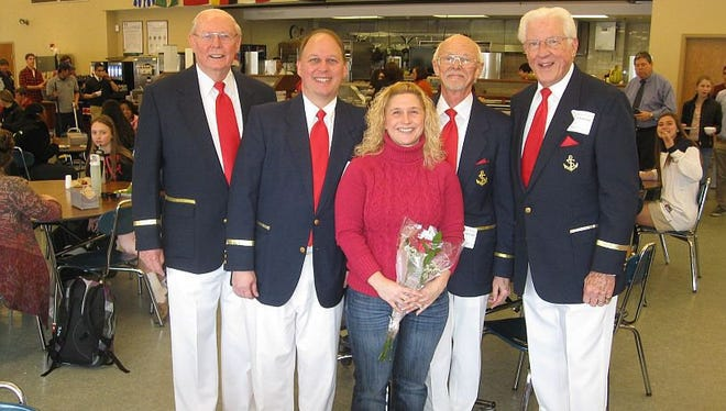 A quartet from the Red Bank Area Chapter of the Barbershop Harmony Society poses with a past recipient of a Singing Valentine at Ranney School in Tinton Falls.