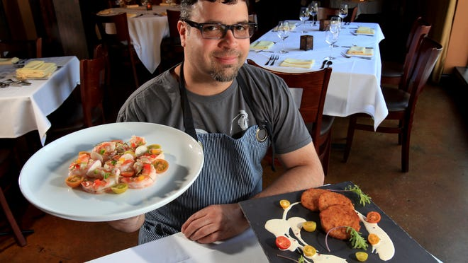 Seviche chef Anthony Lamas holds the pickled shrimp with cumin coriander broth, radish and fennel dish, left, and fried green tomatoes with lemon habanero Mississipi Comeback sauce dish served at the restaurant. May 21, 2014