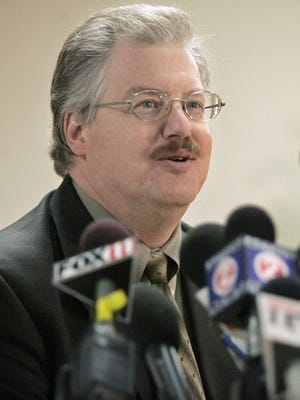 Calumet County District Attorney Ken Kratz talks to the media about the Teresa Halbach case during a press conference in 2005.