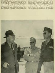 Col. Paul T. Cullen, right, with officials at a U.S. atomic bomb test in the Pacific in the late 1940s. Cullen coordinated aerial photography at these tests. This view is from a once-classified report of the testing.
