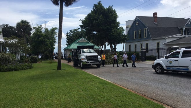 Scene near Indian River Drive and South Street in Titusville where crews work to clean a sewage spill July 31, 2018.