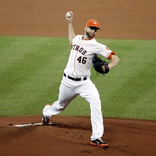HOUSTON, TX - AUGUST 30:  Scott Feldman #46 of the Houston Astros throws a pitch during the first inning of a game against the Texas Rangers at Minute Maid Park on August 30, 2014 in Houston, Texas.  (Photo by Stacy Revere/Getty Images)