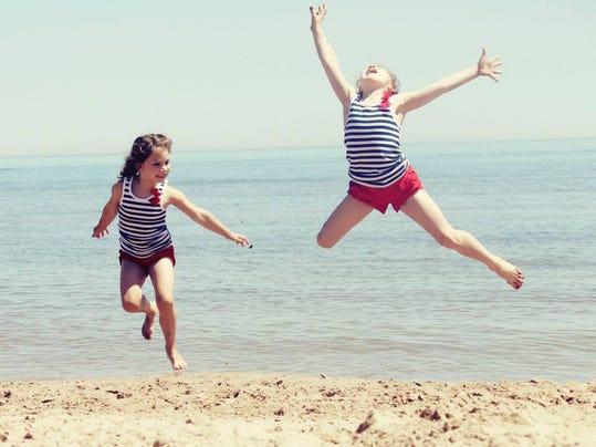 Girls at Neshotah beach 2014.jpg