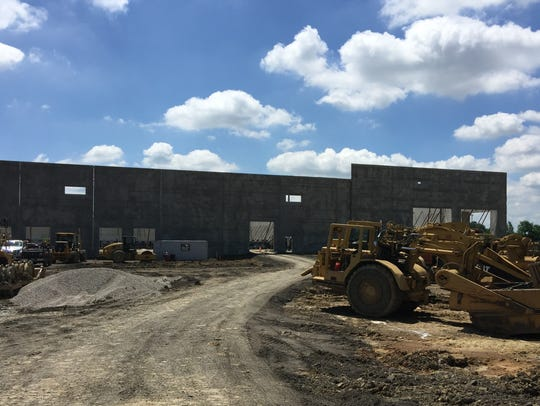 Al. Neyer Construction is putting up a future development at the site of the former Showcase Cinemas in Erlanger on June 28, 2018. Visible from Interstate 71/75, it will be adjacent to the announced Coca-Cola bottling plant, which will be visible from I-275.