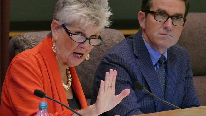 During the Thursday evening Pensacola City Council meeting Sherri Myers, District 2 Council member, gives her opinion about the Eric Olson/Melanie Hicks recent e-mail incident.  Behind her is District 6 City Councilman, Brian Spencer.