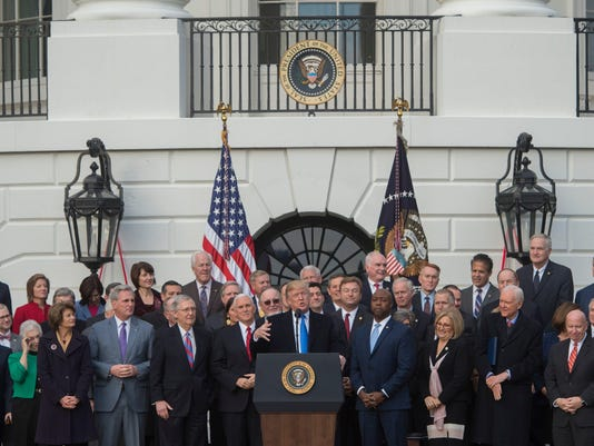 IMG_US_POLITICS_TRUMP_TA_1_1_LUKLD8UF.jpg_20171221.jpg