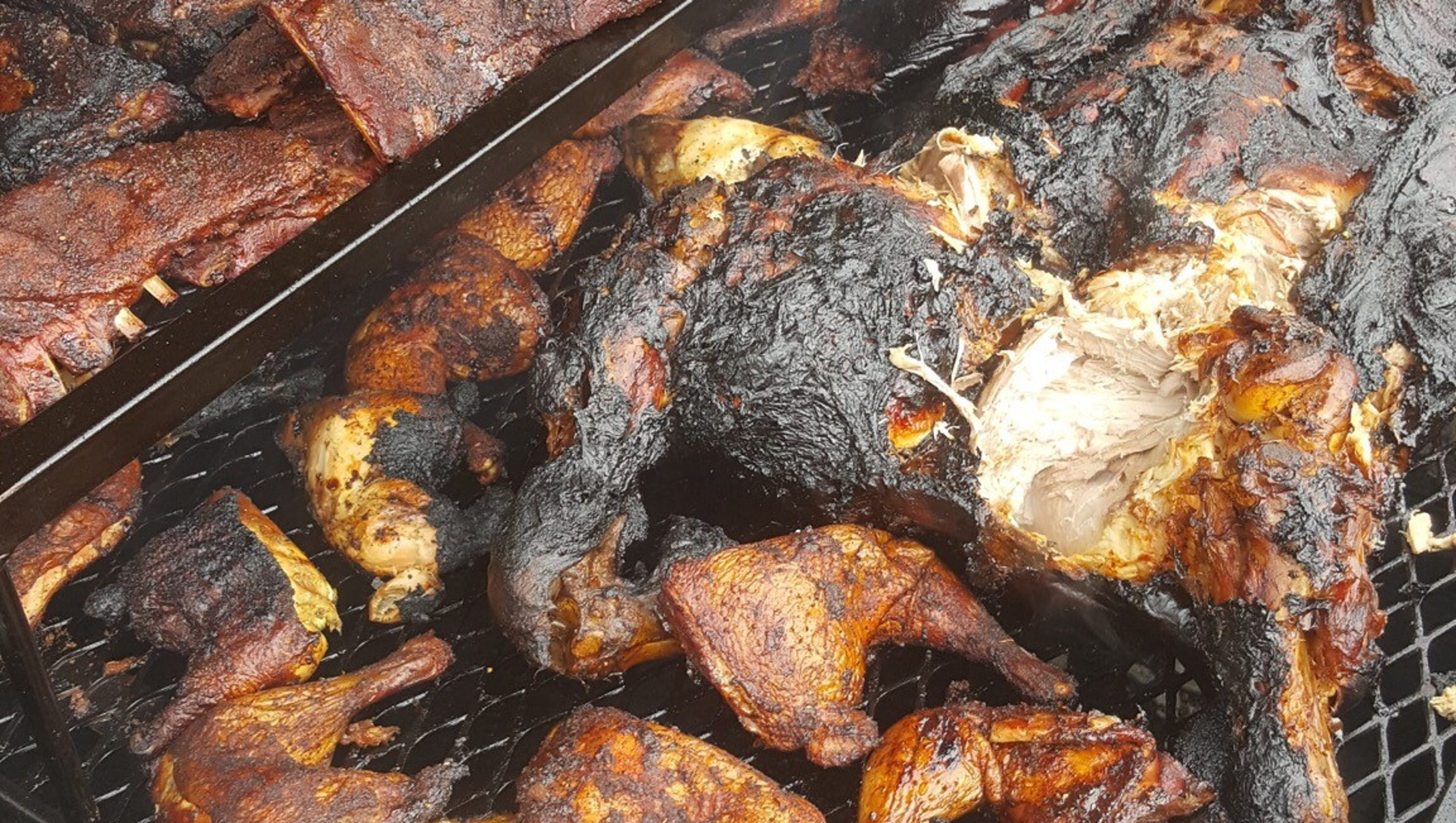 Veterans eat free at Red, White and Que pig roast in Kearny - photo#15