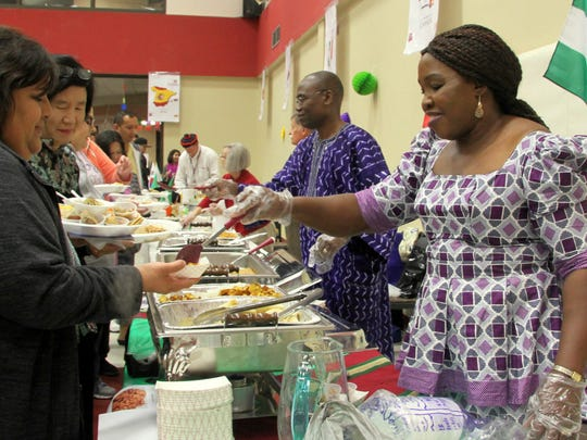Andrew and Grace Nwanne serve homemade Nigerian food at the Taste Culture on Thursday.