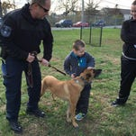 Members of the Wilmington Police Department's K-9 Unit meet with Logan Mast (right) and his younger sister, Emma, Tuesday at the K-9 Academy in Southbridge.