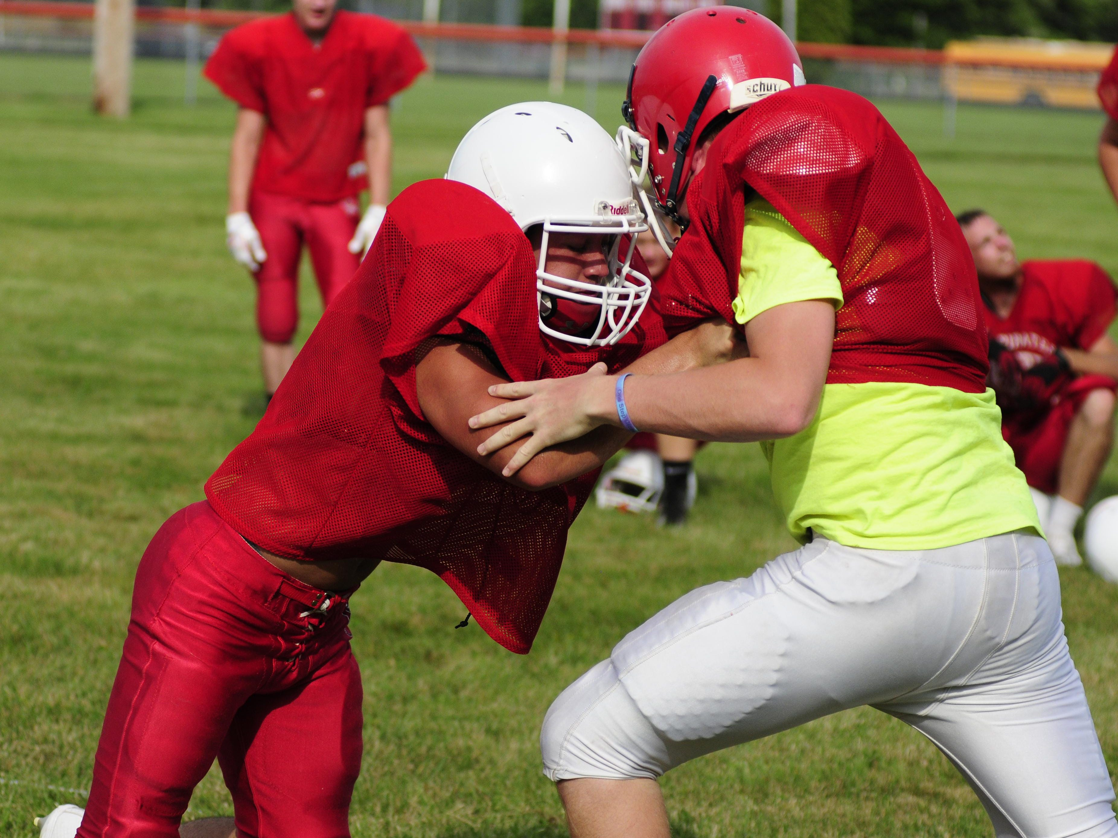 Nathan Rosenthal (left) competes in a drill at Peck football practice.