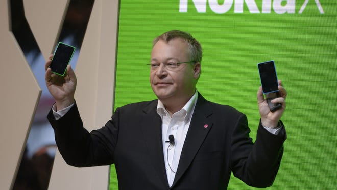Stephen Elop, CEO of Nokia presents the new Nokia X at the Mobile World Congress in Barcelona, on February 24, 2014.  The Mobile World Congress runs from the 24 to 27 February where participants and visitors alike can attend conferences, network, discover cutting-edge products and technologies at among the 1,700 exhibitors as well as seek industry opportunities and make deals.