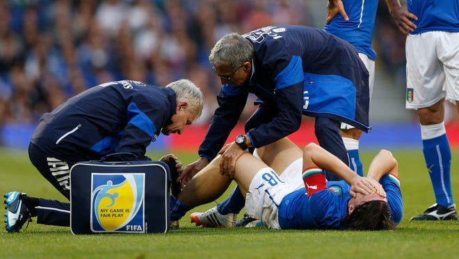 Riccardo Montolivo being treated after suffering his injury at Craven Cottage.