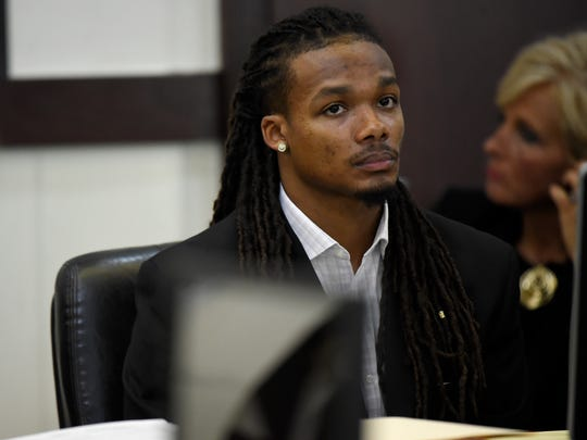 Brandon Banks listens during the third day in his trial