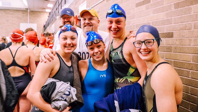 Sault HIgh's Aliah Robertson, Julie Innerebner, Joanne Arbic, and Anna Hildebrand, the UP 200 free and 200 medley relay champions, front row, are pictured at the 2020 Finals with coach Steve Habusta, and back row, left, coach Arbic.