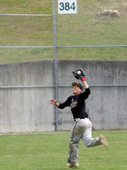 Ben Koler tracks down a fly ball in the outfield at Legion Field in Bremerton. Koler leads the Rangers in on-base and slugging percentage after recovering from a labrum tear suffered as a high school football player.