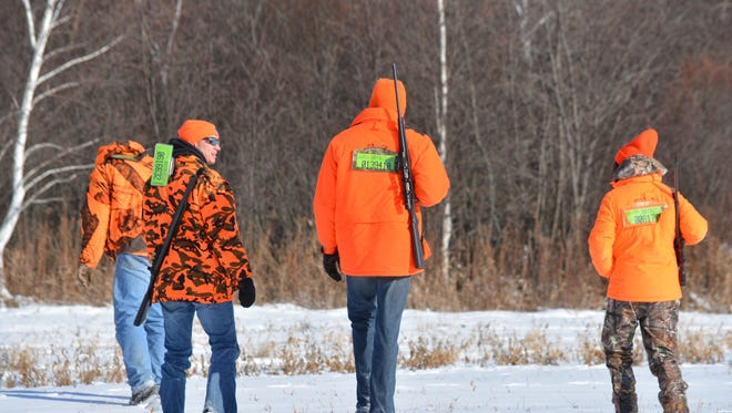 As hunters take to the woods this fall, they won't have backtags on their hunting jackets. The backtag requirement was eliminated by the State Legislature.
