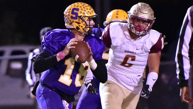 Riverdale's Austin Valentine puts pressure on Smyrna QB John Turner during Friday's contest.