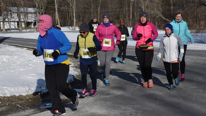 Runners, bundled up for the cold air, take part in the Ed Erichson Memorial Races on March 12.
