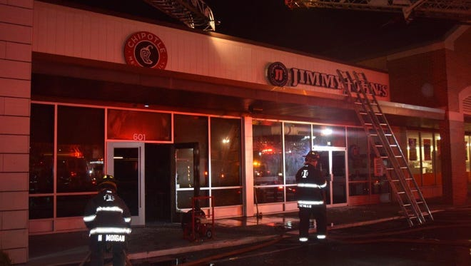 A two-alarm fire damaged four downtown businesses early Monday morning, including Chipotle and Jimmy John's restaurants.