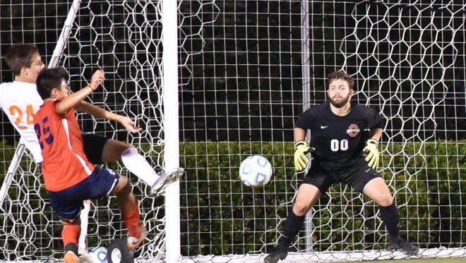 Oakland goalkeeper Jakob Hurst prepares to snag a shot during the 7-AAA finals against Blackman. Hurst battled back from a stomach virus and hospital stay to help the Patriots finish second in the tournament and advance to the region.