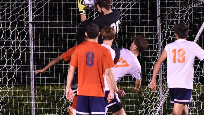 Oakland keeper Jakob Hurst makes a leaping save during the 7-AAA finals against Blackman. Hurst battled back from a stomach virus and hospital stay to help the Patriots finish second in the tournament and advance to the region.