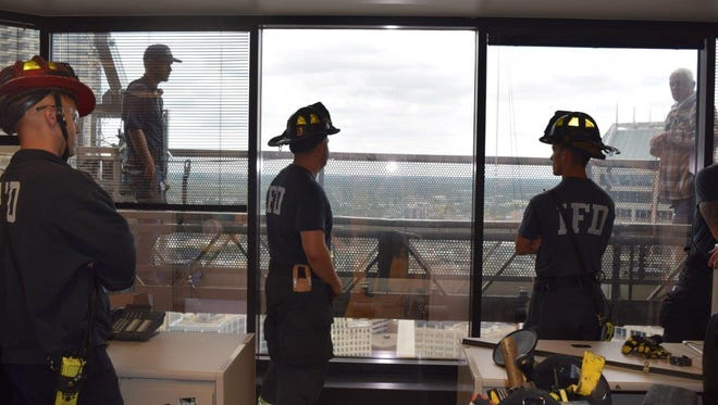 Firefighters rescue two window washers stuck outside One America Building.