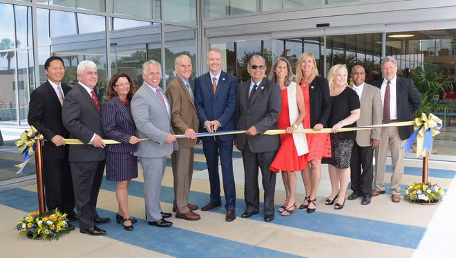 More than 150 people attended the Ventura County Medical Center ribbon-cutting ceremony, including, from left, Dr. Bryan Wong, medical director; Richard Heim, president and CEO of Clark Construction; Joan Araujo, chief deputy director, Ventura County Health Care Agency; county Supervisor Peter Foy; Supervisor Steve Bennett; County Executive Officer Mike Powers; Supervisor John Zaragoza; Supervisor Linda Parks; Supervisor Kelly Long; Kim Milstien, CEO of VCMC; Johnson Gill, director, Health Care Agency; and Jeff Pratt director, public works.