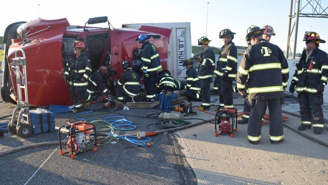 The Indianapolis Fire Department responds to an overturned semi on I-65 Sunday night.