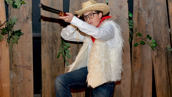 "Ralphie (Ashton Mastalsz) fighting the bad guys with his Red Rider Carbine Action 200-shot Range Model air rifle in ""Christmas Story: The Musical"" which opens at 7:30 p.m. tonight at the Wichita Theater and also plays at 3 p.m. Saturday. The musical runs through December 16."