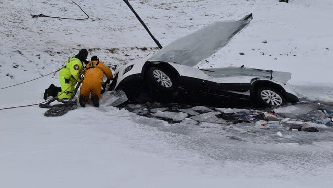 An Indianapolis Fire Department dive team pulled a submerged SUV from a south-side pond on Wednesday, Jan. 3, 2018. Previous attempts to remove the car, which crashed through the ice on New Year's Eve, had been delayed by dangerously cold weather conditions.