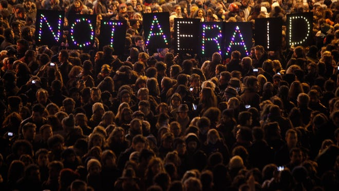 People gather in Paris in solidarity with the victims of a terror attack against a satirical newspaper  Jan. 7.