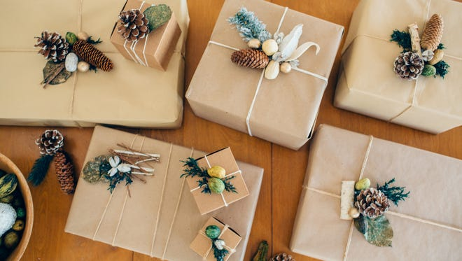 "Prop stylist, craftswoman and the founder of Cargo Creative Shannon O'Neil shows us how to ""spruce"" up holiday presents."