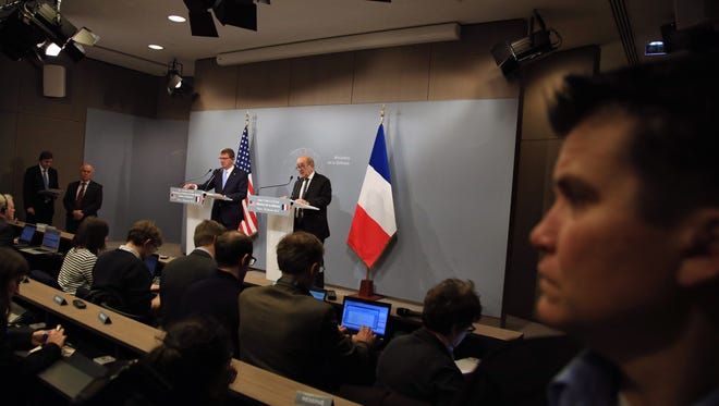 U.S Defense Secretary Ashton Carter, center left, and his French counterpart Jean Yves Le Drian give a press conference, at the defense minister residence in Paris, Wednesday, Jan 20, 2016. Defense Secretary Ash Carter said Wednesday that defense ministers from France and five other nations have agreed to intensify the campaign against Islamic State militants in Iraq and Syria, and that the coalition will work together to fill the military requirements as the fight unfolds over the coming months. (AP Photo/Thibault Camus)