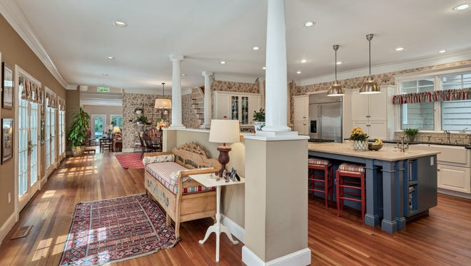 The open floor layout on the first floor features 10 foot ceilings throughout.