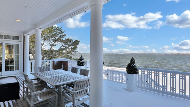 Sit on the porch and enjoy views of Barnegat Bay.