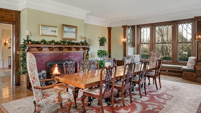 The elegant and massive dining room complete with a fireplace.