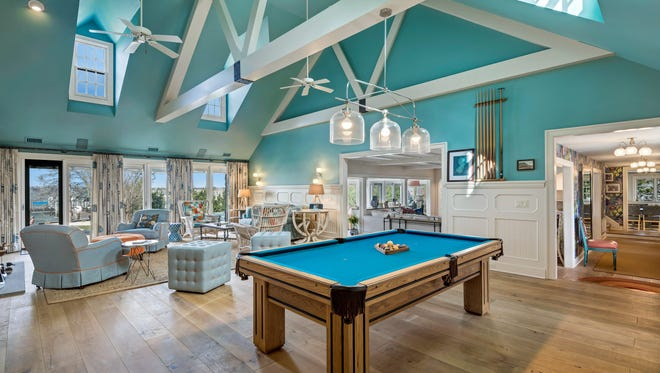 The spacious great room was built for entertaining with cathedral ceilings and stunning hardwood flooring.