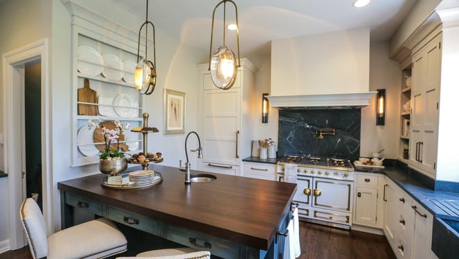 A newly remodeled kitchen designed by KBD Home features a vintage touch at the St. MargaretÕs Hospital GuildÕs DecoratorsÕ Show House and Gardens, April 12, 2017. This year's home, a 1922 arts and crafts inspired residence was the childhood home of Indiana author Kurt Vonnegut Jr., and later well known architect Evans Woollen.