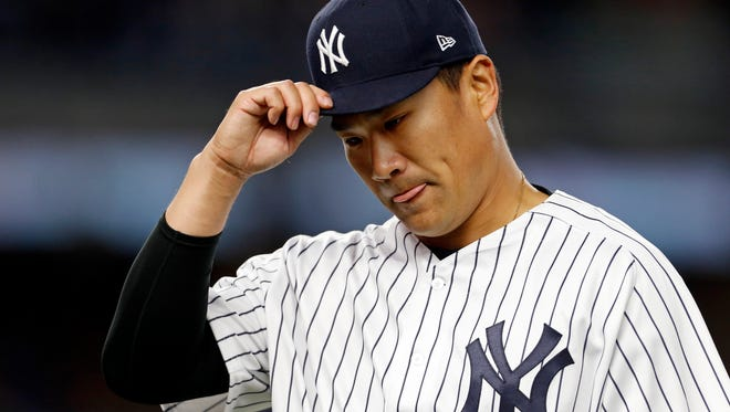 Apr 14, 2017; Bronx, NY, USA; New York Yankees starting pitcher Masahiro Tanaka (19) reacts while walking to the dugout after being relieved against the St. Louis Cardinals during the seventh inning at Yankee Stadium. Mandatory Credit: Adam Hunger-USA TODAY Sports