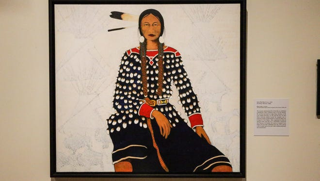"""Elk River Woman, 2002, by Kevin Red Star on display in the  Eiteljorg Museum of American Indians and Western Art exhibition titled """"Indian Market and Festival: Celebrating Twenty-Five Years"""" on Thursday, June 22, 2017. The exhibition runs June 22-July 30."""