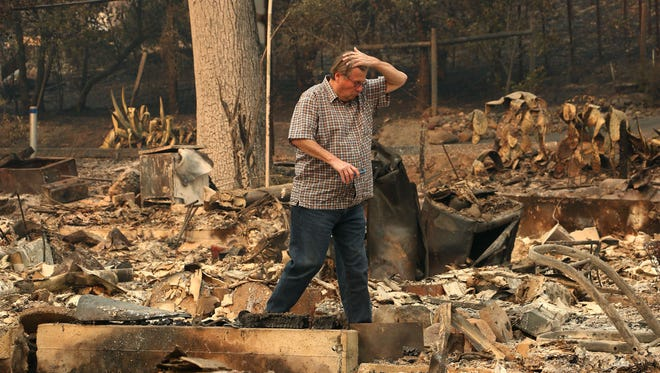 Pastor James Hill surveys the fire damage in Glen Ellen, Calif. on Oct. 11, 2017. Jason Bean/Reno Gazette-Journal- USA TODAY NETWORK
