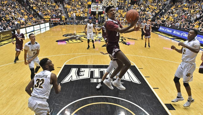 Feb 9, 2017; Wichita, KS, USA; Missouri State Bears forward Alize Johnson (24) drives to the basket against the Wichita State Shockers during the first half at Charles Koch Arena.