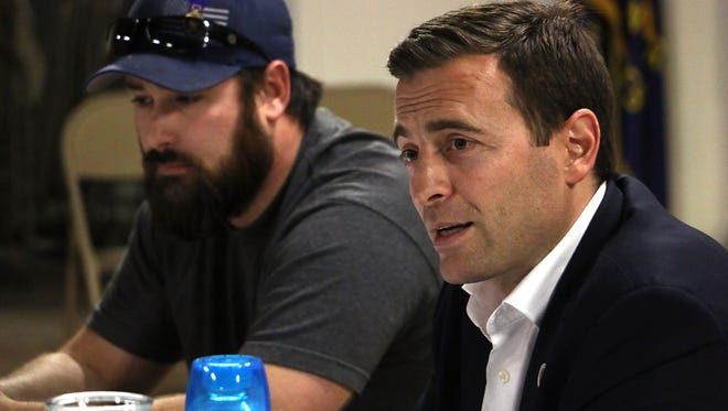 Nevada Attorney General and Republican candidate for Governor Adam Laxalt, right, speaks to a group of veterans at VFW Post 9211 in Reno on Jan. 30, 2018.