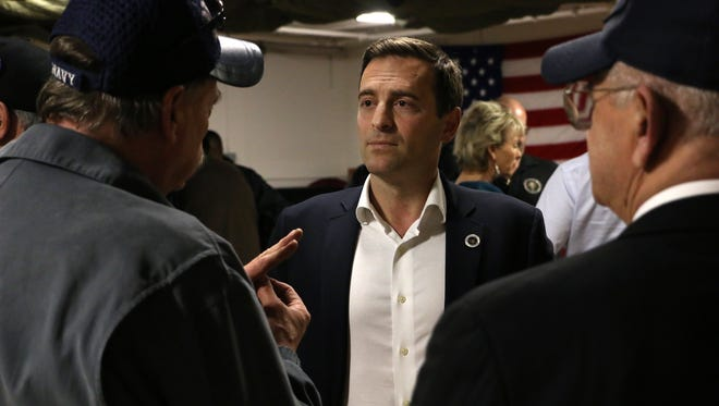 Nevada Attorney General and Republican candidate for Governor Adam Laxalt, middle, listens to the concerns of a group of veterans at VFW Post 9211 in Reno on Jan. 30, 2018.