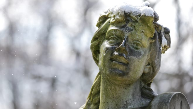 Snow clings to a statue on the grounds of Indianapolis Museum of Art at Newfields in Indianapolis on Monday, April 2, 2018.