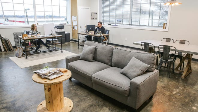 Lara, left, and Sean Rapp of Heritage Builders work in their large office space at Refinery 46, a co-working space geared toward contractors, home services and construction companies in Indianapolis on Tuesday, April 3, 2018. The building, located at 2201 E. 46th St. was formerly the home of Double 8 Foods Inc.
