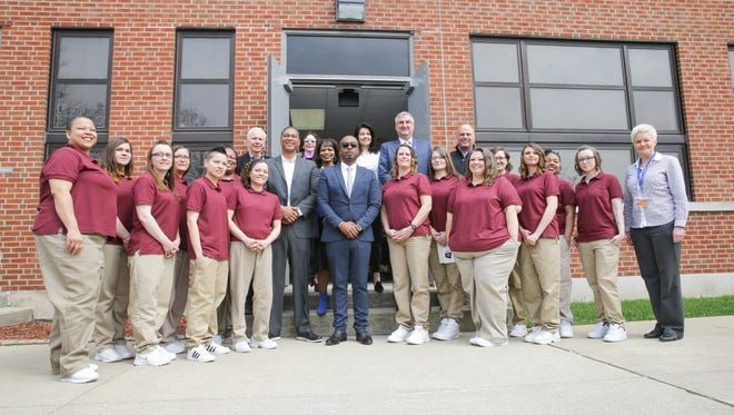 Women enrolled in The Last Mile program, board member MC Hammer, center, and Indiana Governor Eric Holcomb, upper right, pose for a class photo celebrating the inaugural coding class through The Last Mile program at the Indiana Women's Prison on Thursday, April 5, 2018. Indiana is the first state outside of California to adopt the program.
